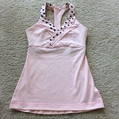 Lululemon Athletic Tank Lululemon Athletic Tank. Light pink with black polka dots on the front. Crossover styling at the chest. Racer back. Light support. Size 4. Excellent condition.  #213 lululemon athletica Tops Tank Tops