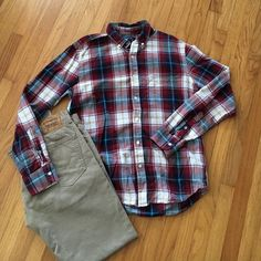 "Men's Old Navy flannel NWOT. Men's slim fit flannel. Color: red, light blue, navy blue, white, and gold. 100% cotton. Chest: 44"". Sleeve length: 25.5"". Length: 29"". Paired with Men's Levis pants. I negotiate within reason, please use offer button.  trades. Old Navy Tops Button Down Shirts"