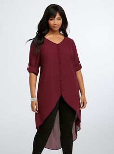"""<p>What's our #currentmood? Old-world details paired with gotta-have-it-now fit. Rich burgundy georgette covers this flowy tunic. The hi-lo hem will flow behind you as you strut, while a button front and tab sleeves are all about old-school sophistication.</p>  <p></p>  <p><b>Model is 5'11"""", size 1</b></p>  <ul> <li>Size 1 measures 29 1/4"""" from shoulder</li> <li>Polyester</li> <li>Wash cold, dry low</li> <li>Imported plus size top</li> </ul>"""
