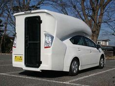 Living in a Toyota Prius was considered difficult to do before the Prius camper van debuted at the 2012 Tokyo Auto Salon. This unique hybrid modification instantly turns the Prius into a liveable space big enough for two.  It features an all-white camper shell with a pink and white interior. On the ground floor there is enough space for either a small sofa or coffee table with the second floor providing the sleeping quarters. Surprisingly roomy.