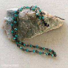Elegant double strand blue green beaded bracelet on gunmetal chain.  One of a kind, designed by Lavish Three. Would make a great Valentine's or Mothers day gift for her! Check out our exclusive line of unique one of kind necklaces and bracelets.
