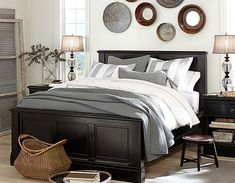 I love this color scheme and look but for family room. Black gray and white w/dark and black wood tones.#potterybarn