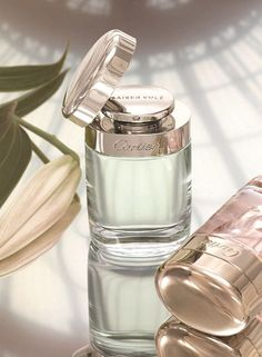 Cartier Baiser Vole. Lily Petals, Green Lily Leaves. Luxury Fragrance - http://amzn.to/2iFOls8
