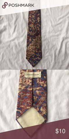 Geoffrey Beene Vintage Whimsical Tie This Geoffrey Beene Vintage Whimsical Tie is perfect for work or a special occasion! This tie was made in the USA and it is 90% Polyester band 10% Silk. This tie is 58 1/2 inches long. Geoffrey Beene Accessories Ties