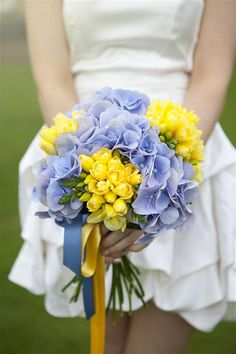 yellow & purple wedding bouquet flowers, image by http://cecelinaphotography.com/