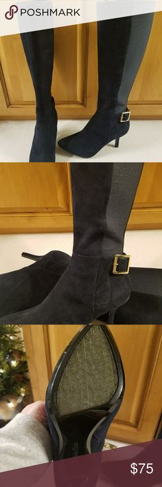"""Calvin Klein navy knee high boots Barely worn, gorgeous navy suede boots.   Loved these boots and as any fashion girl will know navy is extremely hard to find in shoes let alone boots!   But I've gained some weight and cannot get these to zip over my jeans, so my loss is your gain.    Nice 2"""" heel, side zip for entry, mixed media of elastic for the back and suede for the foot portion.    Check out the side buckle, heel plate, and zipper pulls!   All pretty,  shiny gold.... No stains…"""