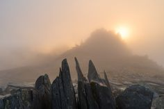 Atmospheric conditions on Glyder Fach as the sun breaks through the previously thick clag to cause an unexpected sunset at Castell Y Gwynt.
