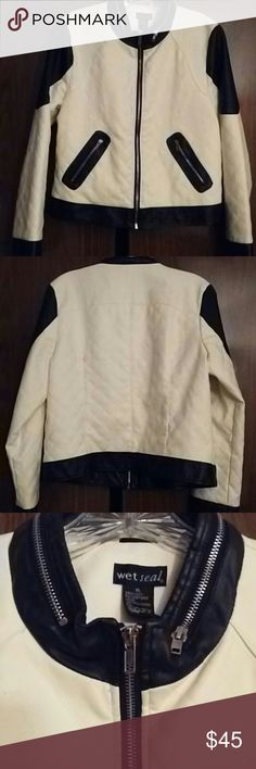 Faux Leather Jacket Gorgeous and unique black and white faux leather zip-up jacket with zipper detail collar, and 2 side pockets. Tag says XL, but fits like a Medium. No stretch. 100% Polyester. Wet Seal Jackets & Coats