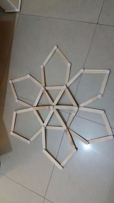 Kids game using ice Popsicle sticks and scotch tape