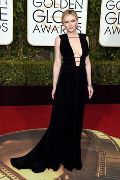 Kirsten Dunst flaunted her assets in a Valentino gown at the 2016 Golden Globes.