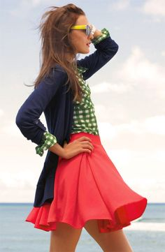 Navy cardigan, green and white checks, pink salmon skirt, and yellow sunnies.