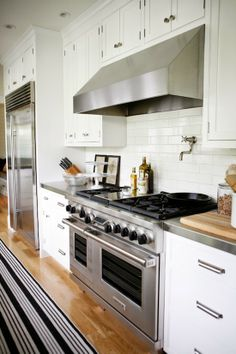 Modern Farmhouse kitchen with subway tile and stainless hood