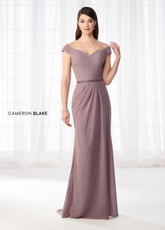 Cameron Blake 218626 This graceful Off the Shoulder chiffon slim A-line gown includes a directionally pleated surplus bodice with a dipped neckline, a detachabl Mother Of The Bride Dresses Long, Mothers Dresses, Cameron Blake, Off Shoulder Gown, Shoulder Straps, Womens Dress Suits, Mom Dress, A Line Gown, Bride Gowns