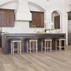 Aequa Silva porcelain wood-look tile is the synthesis of digital technology applied to aesthetic research. Giving the appearance of a reclaimed wood, this series provides the warmth of timeworn material that has taken on new colors and nuances over time. https://arizonatile.com/en/products/porcelain-and-ceramic/aequa#utm_sguid=149397,7dc29458-3c61-e326-8b92-c2b9c3e88f54 #woodlook #tile #nature #floor #woodfloor #tilefloor #woodtile #natural #digital #interiordesign #kitchen #kitchendesign…
