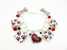 Puppy Dog Love scrabble tile charm and bead bracelet.  Features a red glittering heart and Swarovski beads.  Find this and more at www.wiredboutique.etsy.com  $23.00