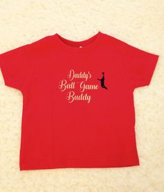 A personal favorite from my Etsy shop https://www.etsy.com/listing/568242783/kids-sports-shirt-daddys-ball-game-buddy