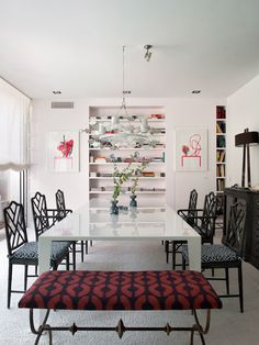 [The red and black bench adds a nice touch of Steampunk to this room. Fun. I like the art, too; it gives a sort of positive/negative effect. Or figure and ground, or whatever term you like to use.]  Isabel López-Quesada | Projects