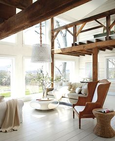 Combining hand hewn beams, or reclaimed wood  furniture will add interest and texture to your white walls and white slipcovered furniture.  Be sure to paint the ceilings and woodwork with a complementary shade of white for a clean, linear look in your space.