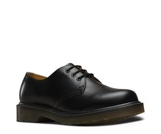 1461 3-eye shoe with our plain welted sole, which has no visible construction thread. Made with our smooth leather, the classic Dr. Martens leather, durable, with a smooth finish. Made with Goodyear welt, the upper and sole are heat-sealed and sewn together.