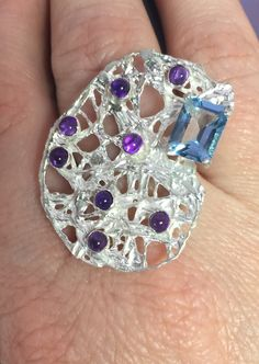 Sterling silver ring accented with topaz and amethysts