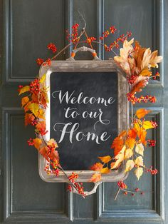 Greet guests with this charming alternative to a fall wreath. Simply apply a layer of chalkboard paint to the inside of an old tray, then add autumn branches and bittersweet berries for a seasonal finish. (Swap in evergreen and holly for the holidays!)