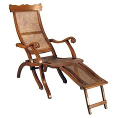 Indian  Mid 19th Century  Anglo-Indian Colonial folding extension arm chair with shaped crest rail and caning. Caning beautifully restored.