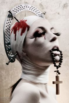 I am loving the mashup of religion and medical misery in this. Especially using a cranial bracket as a halo.