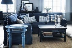 Plaid throw pillows add playfulness to a so-serious, steeped blue couch. | EKTORP Sofa in Jonsboda blue, @IKEAUSA