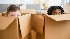 Turn a Plain Cardboard Box Into a Super Cool Playhouse With this Easy DIY