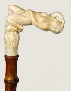 Nude female handle walking stick