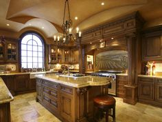 Seriously one of my dream kitchens - though I am not a fan of the painted mural!