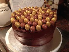 Chocolate fudge cake, chocolate fudge frosting / icing with maltesers and Galaxy golden mini eggs to decorate for a 7 year old girl's birthday cake. Chocolate Fudge Frosting, Cake Chocolate, Mini Eggs, Birthday Cake Girls, Icing, Easter, Candy, Desserts, Food