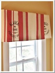 Dish Towel Valances.  I have done this sort of thing before, but used cloth dinner napkins.  Need to remember this....