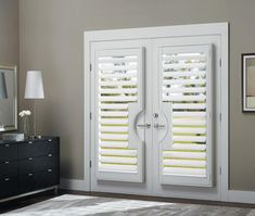 Have beautiful glass doors but need a little privacy? Check out our Hunter Douglas Heritance® Hardwood Shutters! These window treatments dress up your French doors beautifully & are available in over 35 colors and any custom color you can envision.