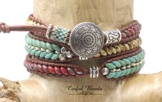 Southwestern Leather Bracelet-Turquoise and Beige Picasso Superduos-Silver, Copper, Dark Bronze Tile Beads-Southwestern Leather by CinfulBeadCreations on Etsy Wrap Bracelets, Leather Bracelets, Leather Jewelry, Bangles, Beaded Bracelets, Jewelry Crafts, Jewelry Ideas, Jewelry Box, Vintage Jewelry