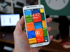 This is the Moto X. It has a pure Android OS with no bloatware. It is a 100% Google only phone. Google bought Motorola and then came out with this phone. It is the only Smartphone built in the USA. Most things you can do with out ever touching it. It's voice commands are fantastic. Check out  https://www.youtube.com/watch?v=TRwT4VErCqQ for all the features