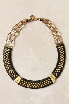 Hand-braided sheepskin leather + gold-plated brass choker by Wing (Anthropologie)
