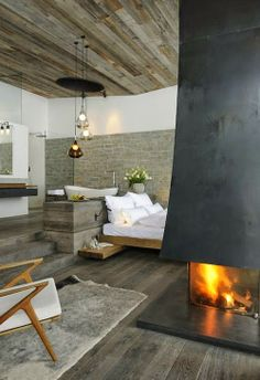 rustic timber ceiling and a fabulous fireplace