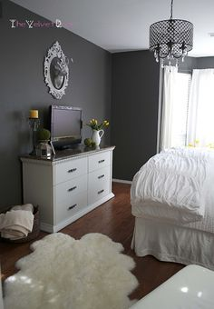 Like the colors: dark grey walls with white and yellow accents! The Velvet Door: Our Master Bedroom TV Wall