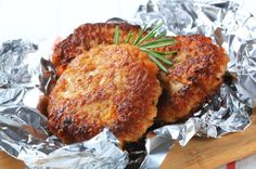 Three vegetable burgers on a sheet of tin foil.