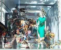 Enchanted animals, objects and mannequins are covered in elaborate tapestry at Hermes. Hybrid animals are conjoined, as well as the use of mirror on the floor and back wall to reflect - continue the objects and animals, making the space more captivating. A truly spectacular window display.