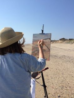Anne painting on the beach in Corolla. Catepetl Art and Frame  Anne Gibson Snyder
