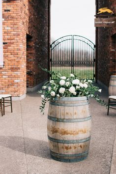 wine barrel with floral arrangement on top Wine Barrel Flower Arrangements, Wedding Arrangements, Floral Arrangements, Whiskey Barrel Flowers, Whiskey Barrel Wedding, Wine Barrel Table, Wine Barrels, Floral Wedding, Wedding Flowers