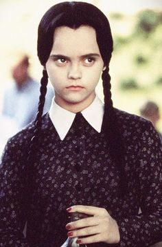 If you can get away without smiling all day, channel the morose Wednesday Addams.