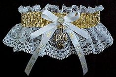 My inspiration. Shiny GOLD Metallic Fancy Bands™ Garter on white lace with a gold 'Love' charm and personalized imprinted ribbon tails. Wedding - Bridal - Prom - Fashion Fun Garter. Visit: www.garters.com/page37d.htm