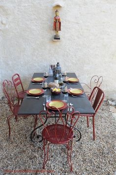 French metal garden table with a collection of different old French chairs.