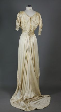 Titanic Era Dress..1900s 1910s Antique Vintage Edwardian Titanic Silk Wedding Dress  Exquisite design from a bygone era. Beautiful lace insets, flowing layered skirt with back train. Back closure. Please take into account that this is a fragile piece of history and may not be suitable for wear.