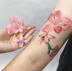 Fuchsia flower tattoos by Rita