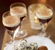 Angel's kiss  This coffee and cream layered cocktail makes a decadent after-dinner drink served with chocolates.