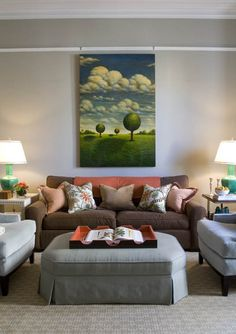 I LOVE the artwork and the casual feel of this living room. - Massucco Warner Miller